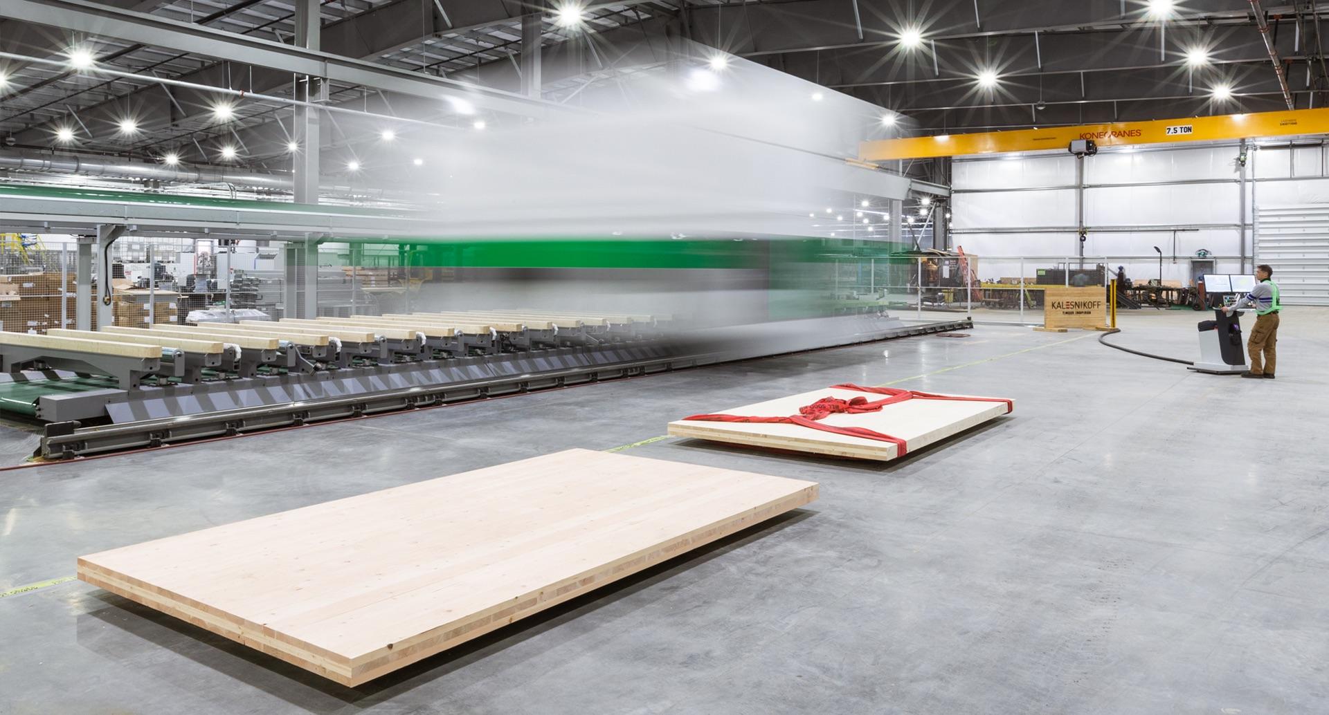 Kalesnikoff mass timber facility showing CNC machine and glulam panels (GLT) made of cross laminated timber