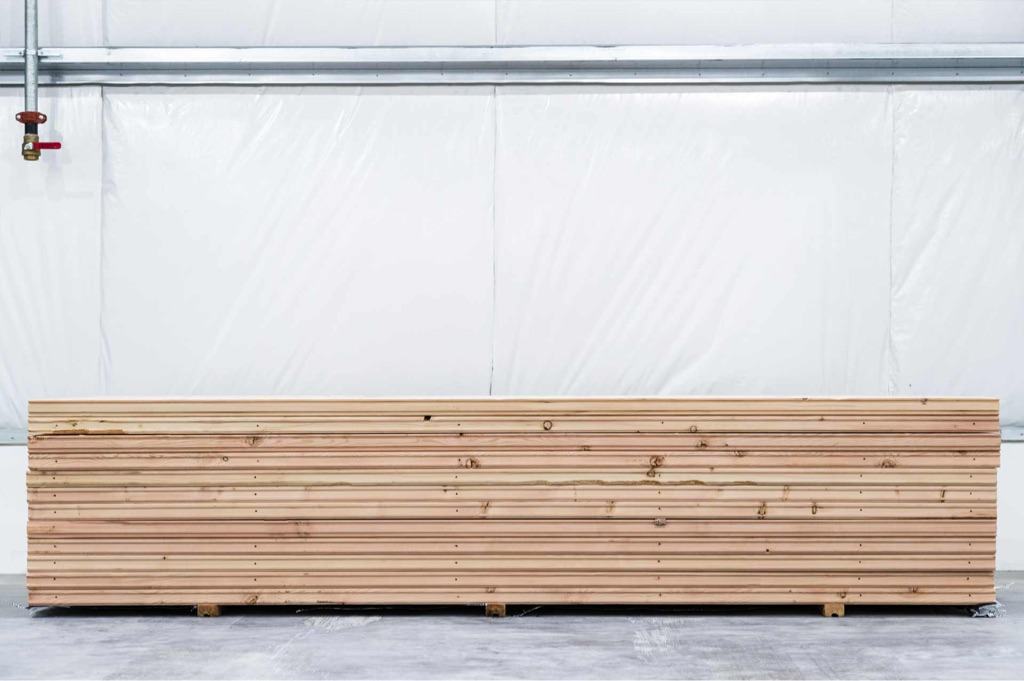 double tongue and groove lumber on pallet in mass timber facility