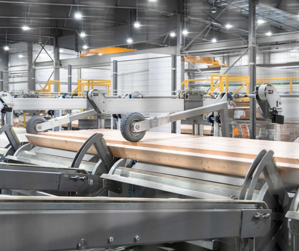 mass timber laminated wood products being processes on production line