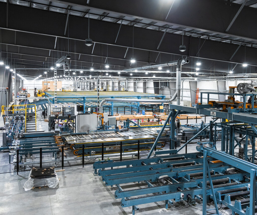 mass timber facility in Canada showing state of the art machinery used to create specialty engineered wood products such as manufactured wood flooring, heavy timber framing and laminated lumber