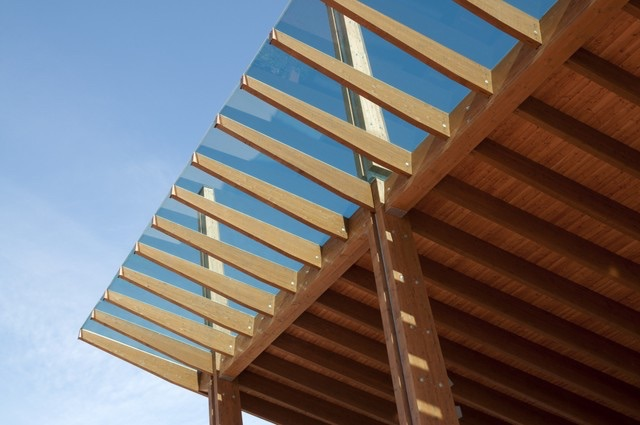 corner angle view of engineered cross laminated timber roof with numerous CLT beams and glass a overhang