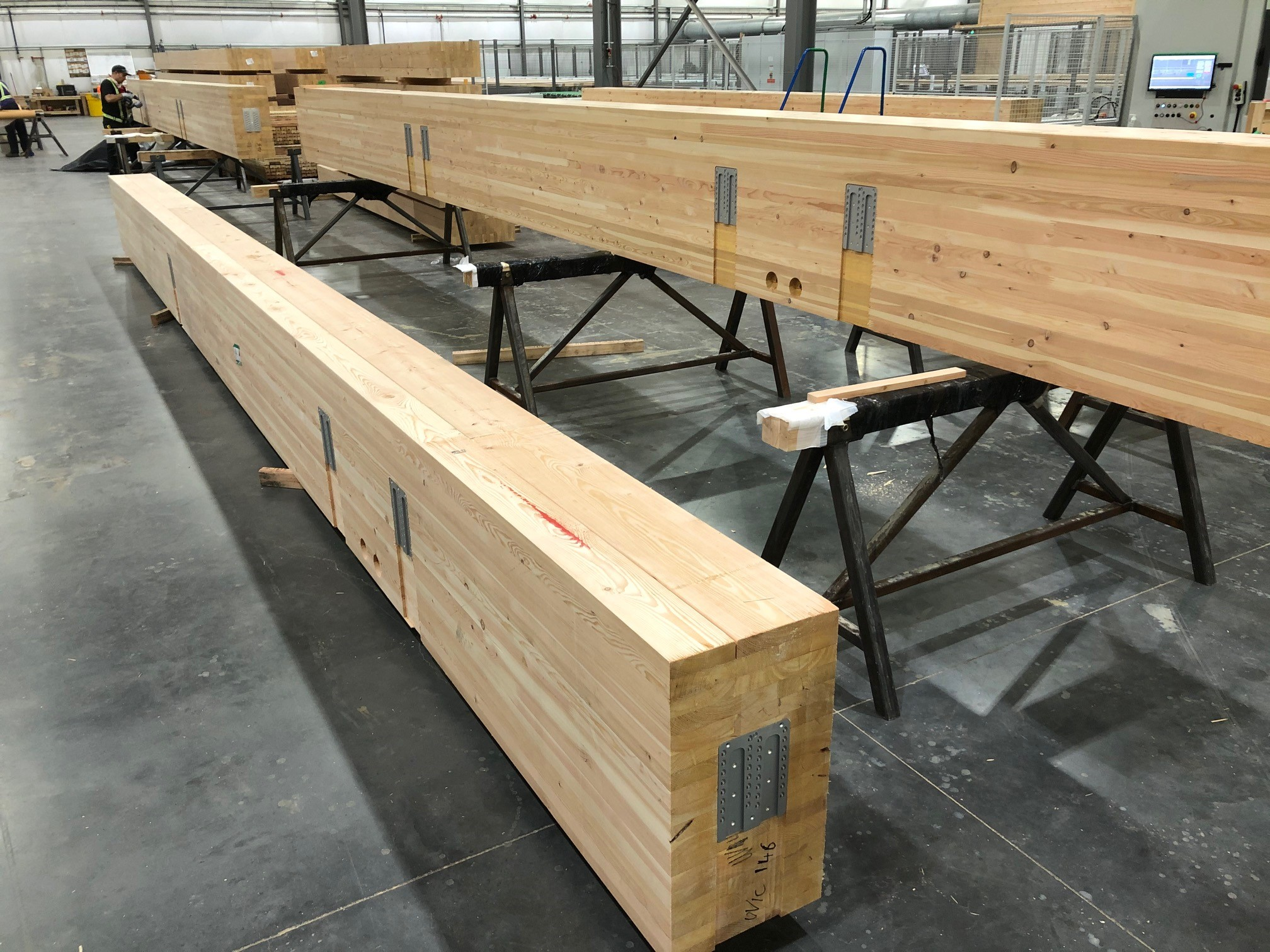 Fir Glulam Beams being prefabricated with hardware